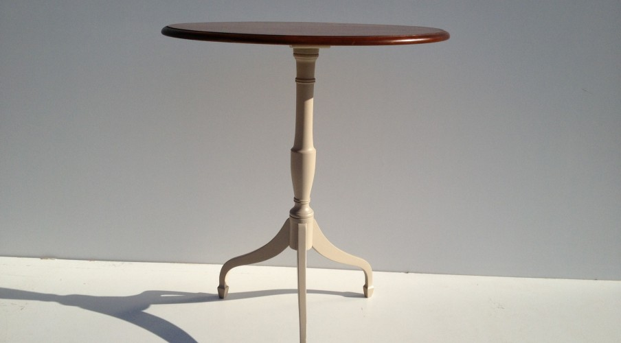 sapele table, legs are painted in a cream and base isl acquered