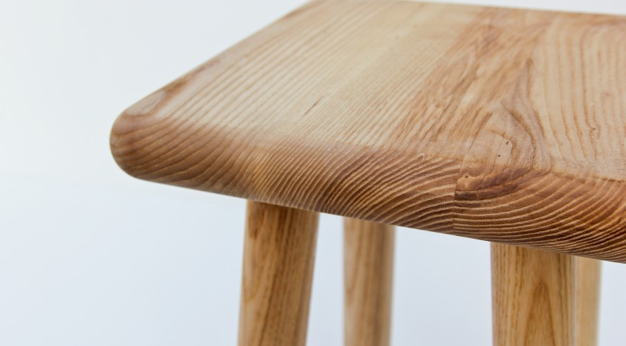 a square stool made from solid ash